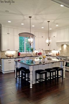 Looks like my kitchen if I had dark floors and pendent lights