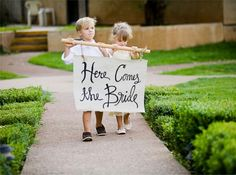 """Here Comes the Bride"" Banner held by Flower Girl and Page Boy"