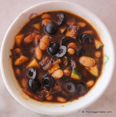 White beans and black olives combine with various herbs and veggies to make a hearty soup.