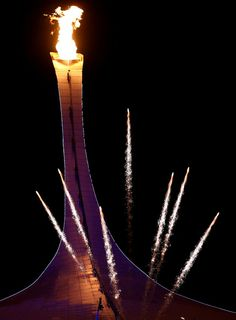 Fireworks explode while the Olympic flame is lit during the Opening Ceremony of the Sochi 2014 Winter Olympics at Fisht Olympic Stadium on F...