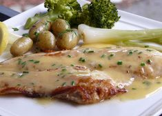 Thibeault's Table: Petrale Sole with a Beurre Blanc Sauce _ Last night we had it pan fried and topped with a beurre blanc sauce. Garnished with chives.