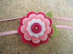 $4.95 + 2.25 (.50 with another item), Maple Sugar Lane Baby Pink Layer Daisy Felt Flower with Elastic Headband