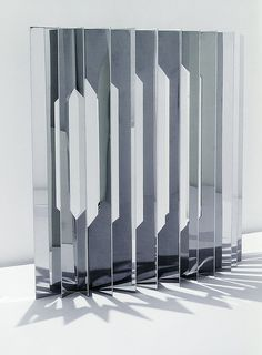Screen by New York City based designers Aranda / Lasch, mirror polish stainless steel