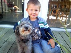 K, now 3, has learned how to be gentle with his doggy friend Belle