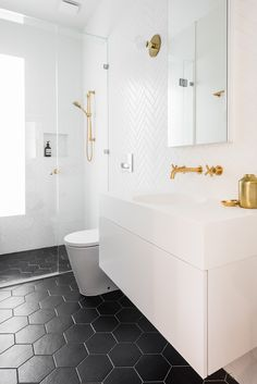 Home Interior Company Modern bathrooms call for sleek, contemporary finishes with a sophisticated edge. No better way to achieve a streamlined bathroom than with metro tiles from the floors to the walls and more. Here we share some of our favourite me. Bathroom Renos, White Bathroom, Bathroom Renovations, Small Bathroom, Master Bathroom, Modern Bathrooms, Black Bathroom Floor, Bathroom Faucets, Hexagon Tile Bathroom Floor