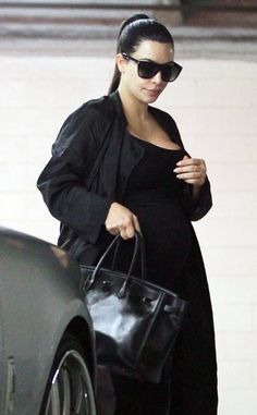 Kim Kardashian's pregnancy style consists of all black everything, including her flat-top, oversized square sunnies!