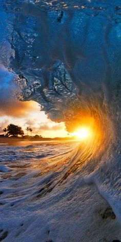 ~~Twinkle | the sun sets as a wave rises on the shores of Hawaii | by CJ Kale~~