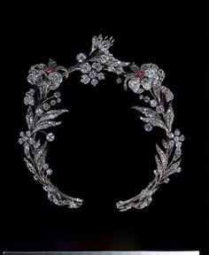 1835 Ruby and Diamond Tiara/Necklace, Victoria & Albert Museum, London. Set in silver on a gold frame, rubies, brilliant-cut and rose-cut diamonds. For such a tiara to survive is quite rare. Usually floral tiaras were broken apart in the late early Twentieth Century and made into brooches. This one has only had one adaptation. The frame was slightly altered so that it could be worn as a necklace.