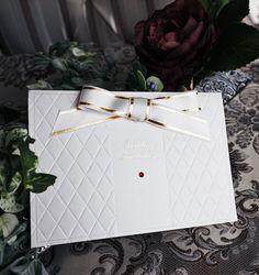 結婚式 招待状【プリメーラ】すごいこだわった加工で キルトに煌めく紙質(^o^)  特注の金箔を施したリボンとルビーのスワロフスキーが絶妙のバランスです。 可愛らしいけど大人しいデザインに仕上げました。 スワロフスキーがダイアも別にありますよ。 by チーフ・アートディレクターおがってい   WEBDING|ウェブディングでは148種類の招待状がHPから無料サンプル請求OK!、日本橋店ではペーパー相談会随時開催中(予約優先 03-3527-3868) #ウェディング #ペーパーアイテム #結婚式 #結婚式招待状 #手作り #DIY