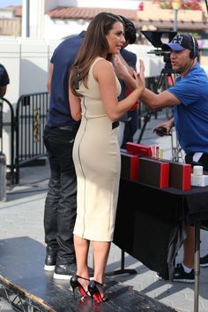Lea Michele booty in a curve hugging dress on set of 'Extra'