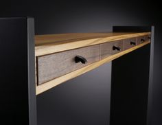 The drawer bunk of this original table design is made of salvaged Russian Olive with salvaged Claro Walnut drawer fronts. Drawer pulls are carved Ebony. The legs are ebonized Ash. Four and five drawer