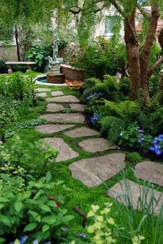 I like the shape of the stones and that the path isn't too straight. Would love to create gardens like this on my property.