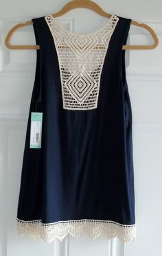 """Papermoon Lonni Crochet Back Knit Tank from Stitch Fix in Navy. Soft Rayon/Spandex blend, very flattering and not overly flowy. It measures 25"""" long. https://www.stitchfix.com/referral/4292370"""