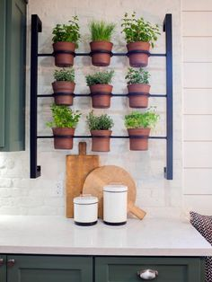 This+wall-mounted+herb+planter+in+the+new+kitchen+represents+the+combined+efforts+of+two+local+artisans+–+a+potter+and+metalwork+specialist.