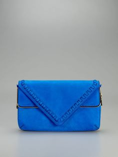 Love this! Great color and details! ( Carla Suede Triangle Clutch by Brian Atwood )