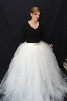 a tulle skirt that you can put over a dress and turn it into a wedding dress? It's a lot more affordable than buying a tulle wedding dress, and you get two dresses in one. The tulle skirt can be worn for the ceremony, then taken off for the reception.
