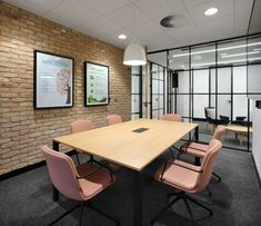 Inspirational Office Design Case Studies | Morgan Lovell | We love the brick wall bringing texture and a rustic feel, against these black framed windows in this meeting room. Blush pink office chairs create a soft, relaxing feel to this meeting space. #MeetingRoom #OfficeDesign #OfficeInteriorDesign Office Meeting, Meeting Rooms, Innovative Office, Building Society, Pink Office, Banquette Seating, Waiting Area, Contemporary Office, Design Case
