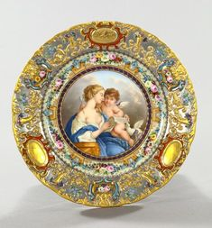"""Fine and Rare Jacob Petit, Paris, Platinum-Ground Porcelain Plate, third quarter 19th century, with an elaborate polychromed and parcel-gilt relief border and centered with a well-painted tondo of """"the Education of Cupid"""", signed on the reverse in underglaze blue: """"J.P."""", dia. 10""""."""