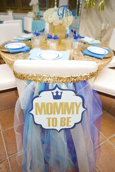 Mommy to Be sign for chair back at baby shower. Dining tables at Fig and Olive Beverly Hills. Blue and gold theme. | Lovelyfest Event Design | Royal Blue Baby Shower