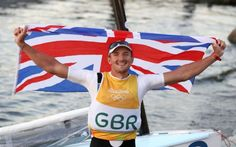 Great Britain's Giles Scott poses with a flag at the Maria da Gloria on the…