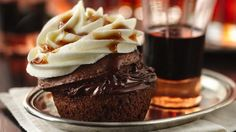 "Taste for yourself what the buzz is all about! A bit of bourbon, a hit of coffee liqueur and some vanilla vodka-spiked frosting make these sophisticated chocolate cupcakes the ultimate ""holiday helpers."""