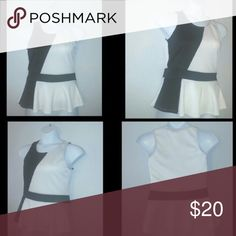 Fabulous peplum, color blocking top This is a fantastic sleeveless, peplum top. This top represents the black and white style perfectly. Ladies size 10. Urvana Tops Blouses