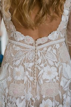Bride wears a bespoke embroidered and embellished gown by Hermione de Paula, with an intricate floral design and shimmering beads in ivory and blush pink. Images by The Georges. #hermionedepaula #longsleevedweddingdress #backlessweddingdress  #weddingdress #weddinggown #bridalgown #bridaldesigner #weddingfashion #weddingstyle