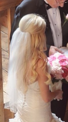 i think wearing your hair down takes away from the dress....but i like the veil placement.