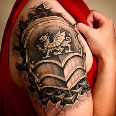 My tattoo. Armor with the Welsh dragon. Tattoo by Robert Black at Black Mammoth Tattoo in Aggieville, Manhattan, Kansas #tattoo #ink #shouldercap