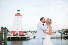 Beautiful photo opp for the newlyweds, Congratulations again Brittany & Jose! #Love #Wedding #Kiss #Newlyweds #Nautical #Lighthouse #DestinationWedding #Travel #FaroBlanco #Bayside #AshleeNicolePhotography