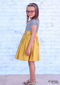 Super cute girl dress love the bow detailing on the front!
