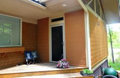 Using Tresco Ginger Sunbrella® Awning and Marine Fabric, the Weather Queen Shades blend in perfectly with the home's siding.