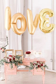 If for some reason your cake table cannot be placed in front of a wall, add an balloon backdrop to define it's space. Of course we recommend gold giant letters in the theme of the evening, LOVE!  CreditsPhotographers:  Monique Hessler Photography View Post Pink And Gold Modern Romance Wedding