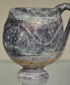 An ancient Roman cup made of fluorite. Such cups were extremely valuable during Roman times. Aside from their outstanding beauty they were known for giving a specific taste to the wine. Pliny the Elder describes one noble who enjoyed his fluorite cup so much that he liked to not only drink from it, but to chew on its edge afterwards. - The Romans loved their poisonous minerals. Over time, fluorite can cause skeletal fluorosis.