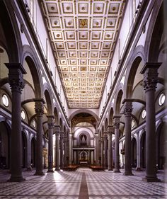 "Basilica of San Lorenzo, Florence by Filippo Brunelleschi (1421-1440) interior showing nave toward the altar -  Brunelleschi used pietra serena, ""the serene stone,"" to help create the calm sense of balance."