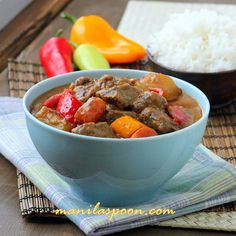 BEEF KALDERETA sa GATA (BEEF CHUNKS STEWED in COCONUT MILK) 1 T Butter and 1 T Olive Oil 2 lbs / 1 kilo stewing beef 6-8 garlic clove 2 onions 4-5 Tomatoes 1 t Salt ½ t Black Pepper 2 t, Fish Sauce 2 Bay leaves 1 cup Beef broth 1 can Coconut Milk 3-4 potatoes 2 carrots Additional oil ½ Red Bell Pepper ½ Green Bell Pepper 1 Chili/hot pepper of choice 2-3 T Del Monte Ketchup/tomato sauce 4 T, crunchy Peanut Butter 1 Chili/hot pepper of choice or ¼-½ t Red Chili flakes*====