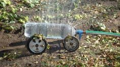 supreme recycling!!! a large plastic bottle with holes poked into it on one side sitting on lawnmower wheels and axles and then water hose attached. voila! sprinkler!     posted on parga's junkyard (fb)