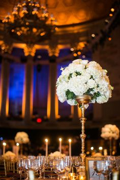 Tall White Flower Arrangement on Gold Riser | Photography: Images by Berit, Inc. Read More: http://www.insideweddings.com/weddings/gatsby-inspired-jewish-wedding-with-purple-gold-decor-in-new-york/720/