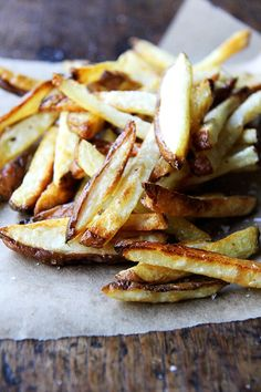 Every summer, when the potatoes start arriving in our CSA, I am blown away by their flavor, by how they need nothing more than olive oil and salt. This recipe for oven fries is especially good, especially crispy on the edges, especially creamy on the inside. // alexandracooks.com