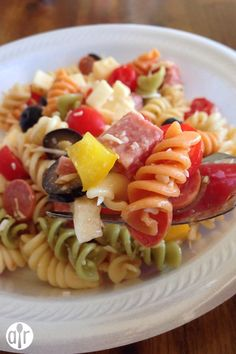 """Awesome Pasta Salad   """"At first I was like """"Who in the world needs a recipe for pasta salad. It's just noodles, random veggies, some cheese and dressing."""" But after trying many times and failing to get pasta salad right I decided I wanted to try a recipe for my daughter's birthday and I'm glad I did. As far as pasta salads go, this was awesome. I really enjoyed it as did everyone at my daughter's birthday BBQ. It's so simple yet so good. This will be my new go-to for potluck BBQ's!""""…"""