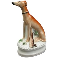 A wonderful Staffordshire deer dog or Greyhound and Hare Figurine. This Antique early Victorian pottery figure is in good used condition with some crazing and minor loss to the paint, see pictures.brDimensions are: 16.5 x 10 x 6.5 cm or 6.29 x 3.93 x 2.55 Inches.brWeight 275.4 grams or 177.1 Pennyweight. Victorian Life, Whippet Dog, Hare, Pottery, Antiques, Pictures, Dogs, Painting, Ceramica