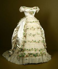 Wedding gown of Elisabeth of Wied, Queen Consort of Romania (Carmen Sylva). The dress is made of silk satin and silk tulle, with cotton and paper faux flowers. (Held at Fashion Institute of Design and Merchandising, Los Angeles. 19th Century Fashion, 1800s Fashion, Victorian Fashion, Vintage Fashion, Victorian Era, Antique Clothing, Historical Clothing, Vintage Gowns, Vintage Outfits