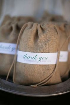Local coffee beans as wedding favors in burlap bags.