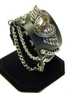 Leather Cuff Wristband with Winged Heart by CreationsbyDreamLady, $25.00