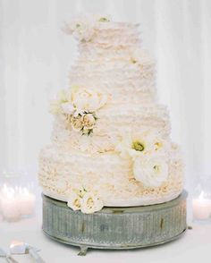 11 Reasons We're Dreaming of a White Winter Wedding Cake | Martha Stewart Weddings - Perfect Endings decorated this four-tier wedding cake with delicate flowers and ruffles of frosting for a snowy effect.