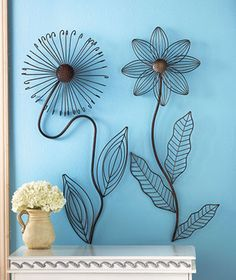 Metal Flower Wall Sculptures (or garden stakes?) $11.95 ea (These are for your wall, but would look great in the garden-at abcdistributing.com as of 5-15-13)