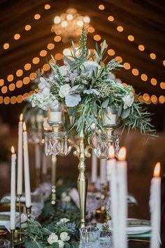 Stunning candelabra arrangements with roses and olive leaves