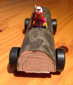 """My son's Pine Wood Derby car named """"The Last Log Standing;"""" complete with a lumberjack.  #cubcontest"""