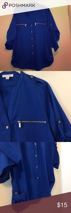 Calvin Klein blouse Royal blue Calvin Klein blouse with gold button and zipper detail. Long sleeves with option to roll and button into 3/4 length sleeves Calvin Klein Tops Blouses
