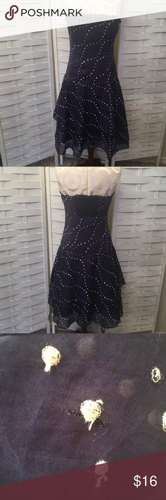 Odille dress *damaged* N.300 Lovely polka dot strapless dress. Hard to find pacific coast dress.It is preloved but still has life left in it. The straps are missing but you can still attach some inside, there are a few holes and some of the embroidered dots are coming undone. All are pictured above and it is priced accordingly.Zipper works and it is fully lined. Anthropologie Dresses